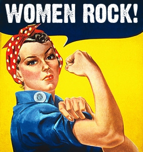 "Stock photograph of the famous World War II poster ""We Can Do It!"" showing Rosie the Riveter wearing a red bandana and flexing her muscles against a yellow background, created by J. Howard Miller. The woman that modeled for this image was actually named Geraldine Doyle and was a real riveter in the 1940s."