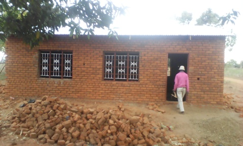 Blog Photo - Kamala-Jean School being built bricks in front